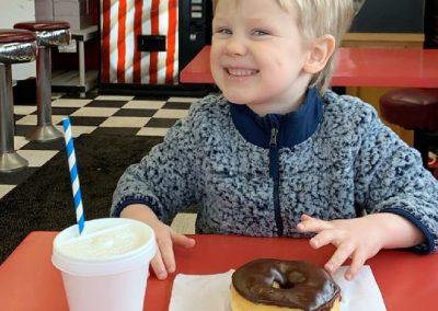 Happy Child Eating Donut Land